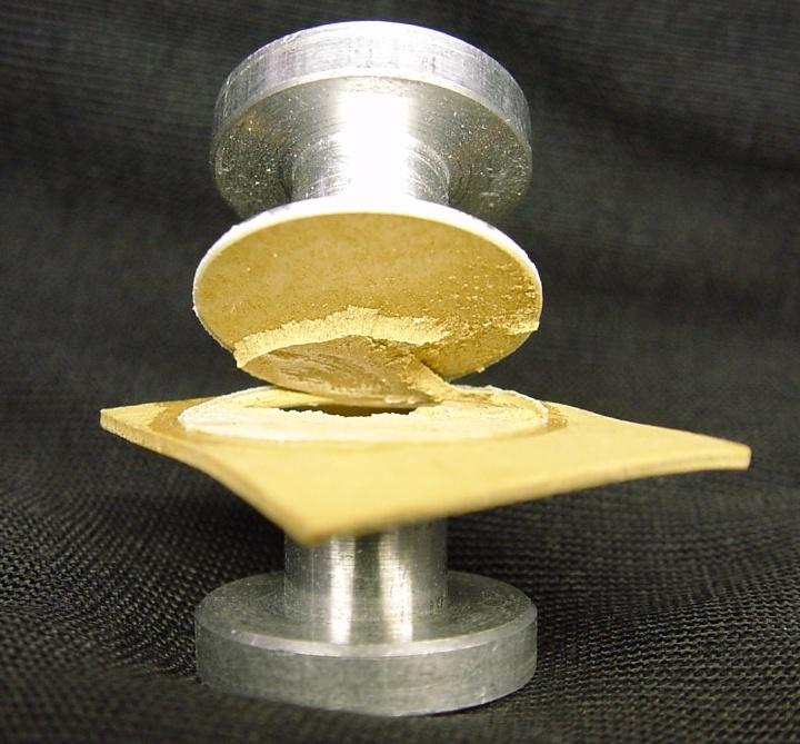 Plasma-activated Teflon glued to metal.
