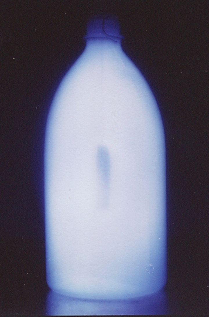 Selective deposition of a thin barrier film on the inner walls of a commercial plastic (polyethylene) bottle. (c)